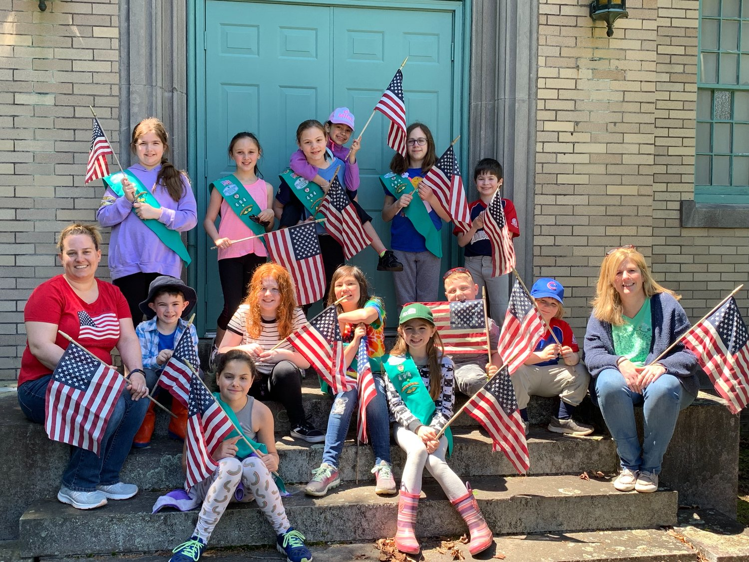 Rehoboth Girl Scout Troop 494 place Cemetery Flags on Veterans Graves