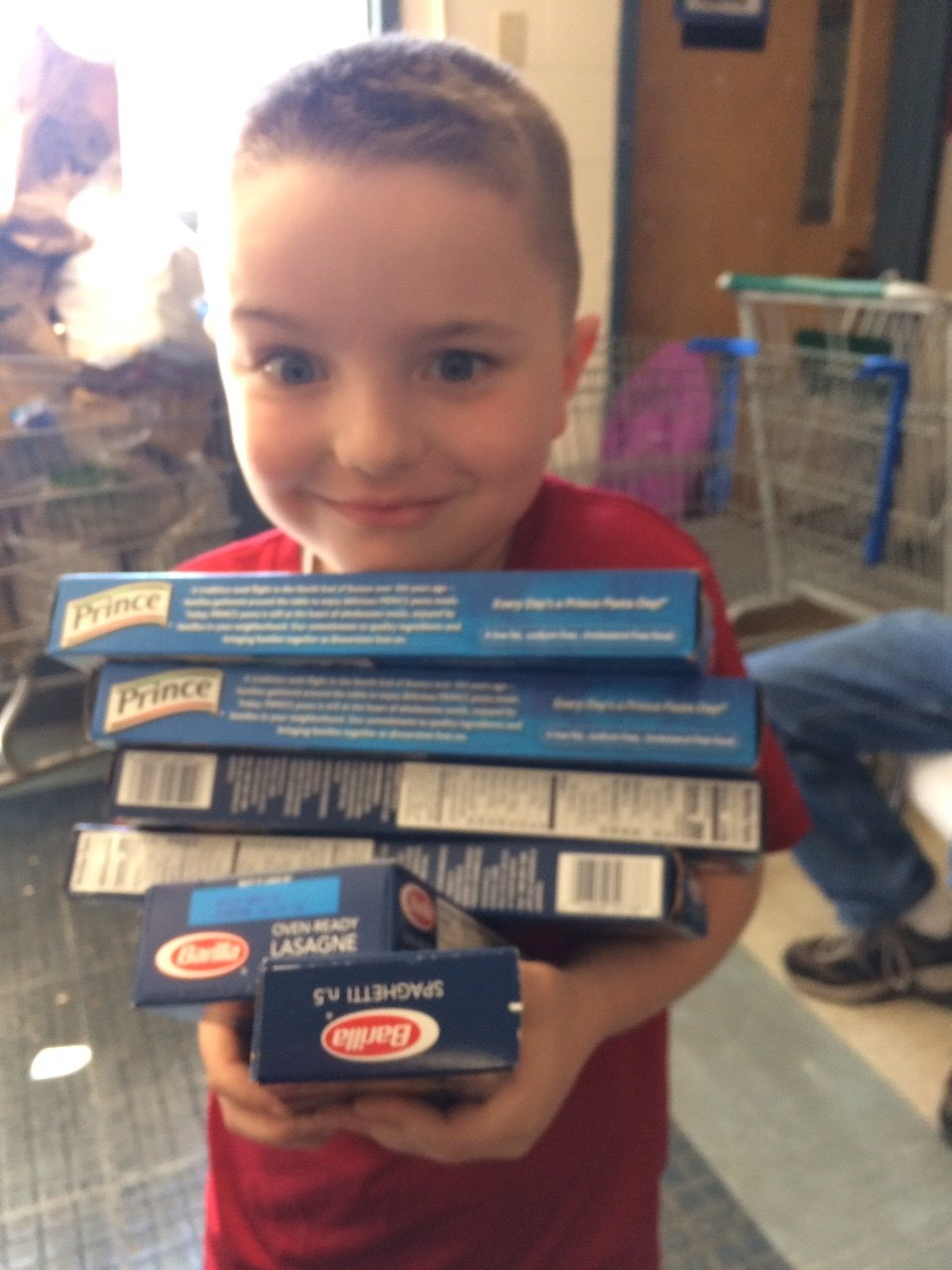 Owen Hodge, age 6, helps sort through food donations during the Letter Carriers food drive. Owen was there with his memere and papi for several hours and was a big help- thanks Owen!