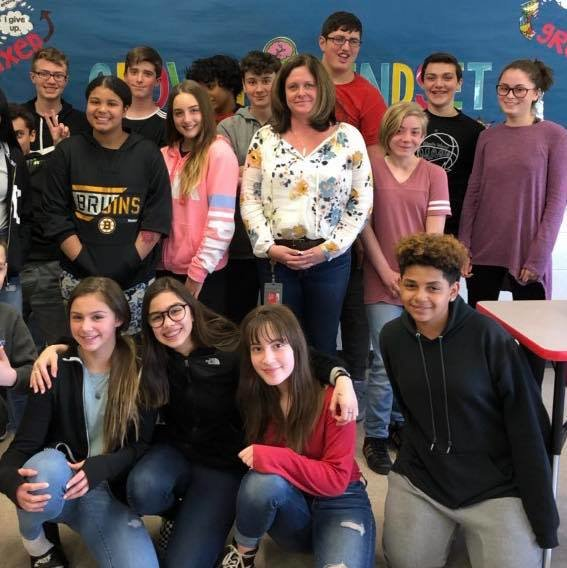 Leila McCarthy, center, is East Providence District Teacher of the Year for 2019. Shown here with many Riverside Middle School students where she is Social Studies Dept Head. RMS photo