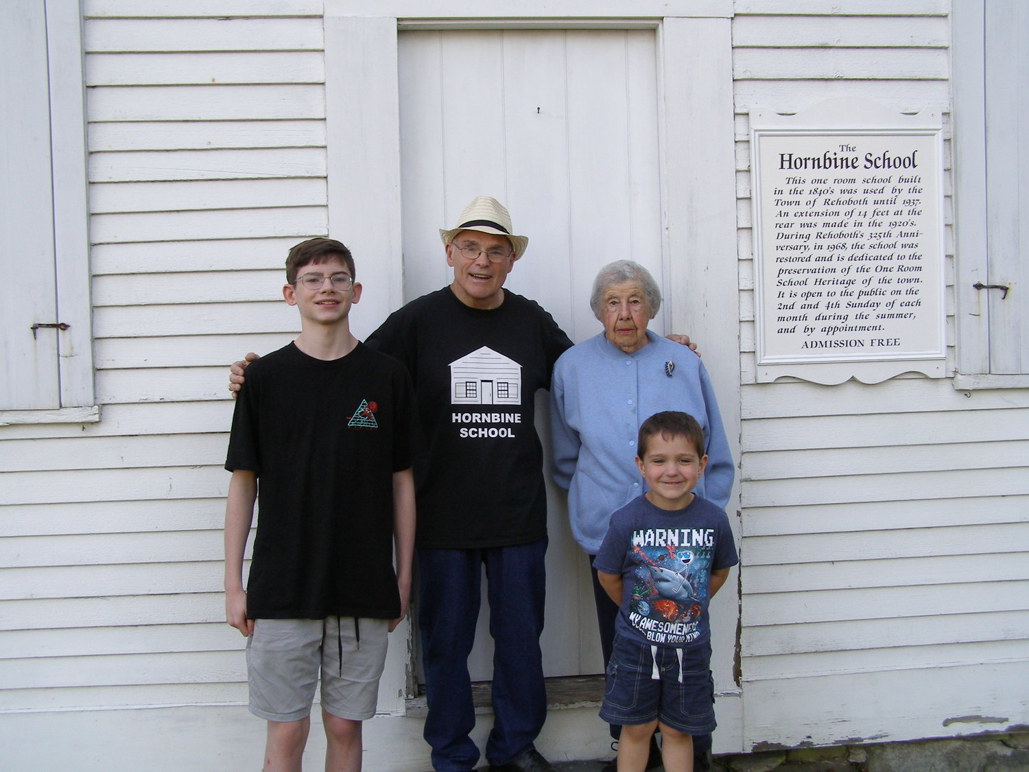 Pictured with past Hornbine School Student, Frances Magan, are Dave Downs who has visited the school for most of the past 47 years; Joshua Faulder, who has visited the school each June 11th for fifteen years; and Caden Lazaro, who has visited the school on June 11th for five years.