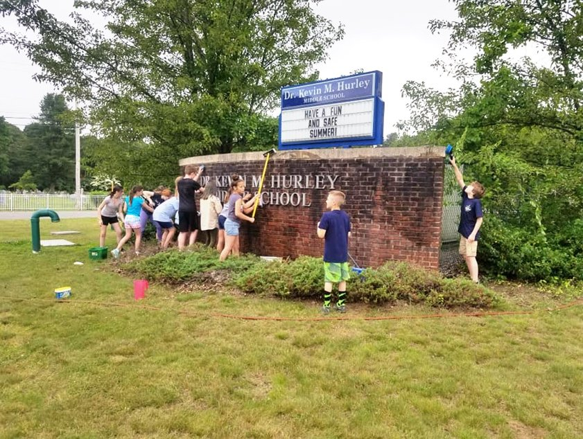 Troop 1 & Troop 9 scouts participated in several community service events this spring. Here they are cleaning the brick sign in front of Hurley Middle School.