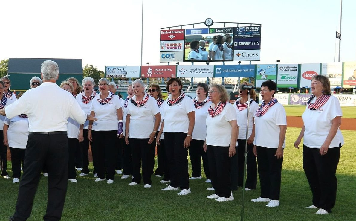 Harmony Heritage, joined by friends and members of NoteAble Blend chorus, sing the National Anthem at McCoy Stadium