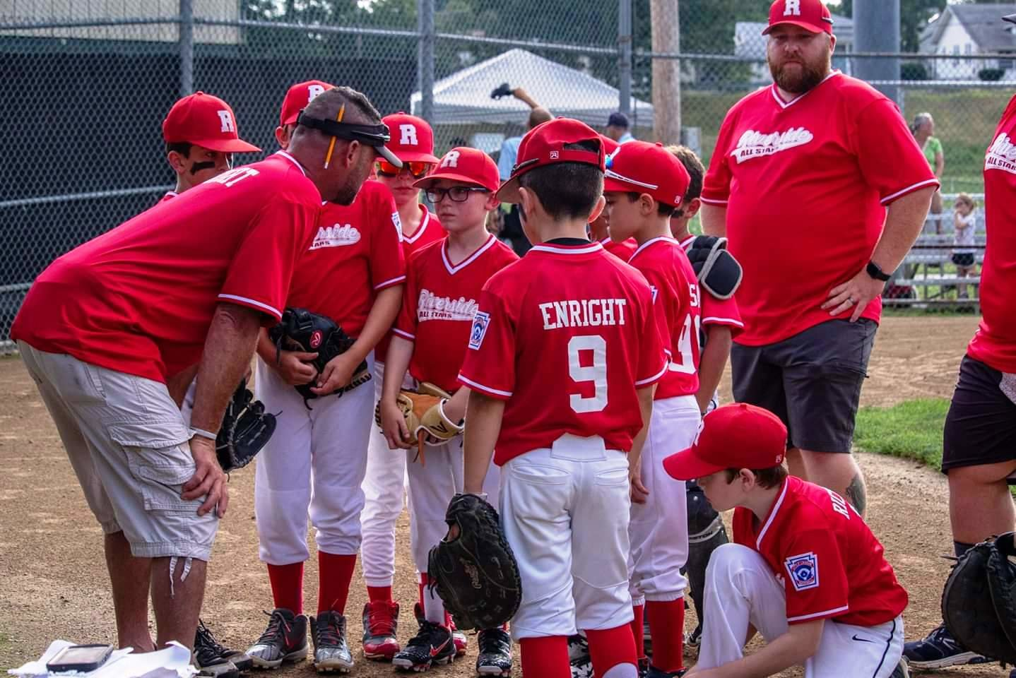 Riverside 9-10 All-Stars listening to Manager Vin Enright in tourney action