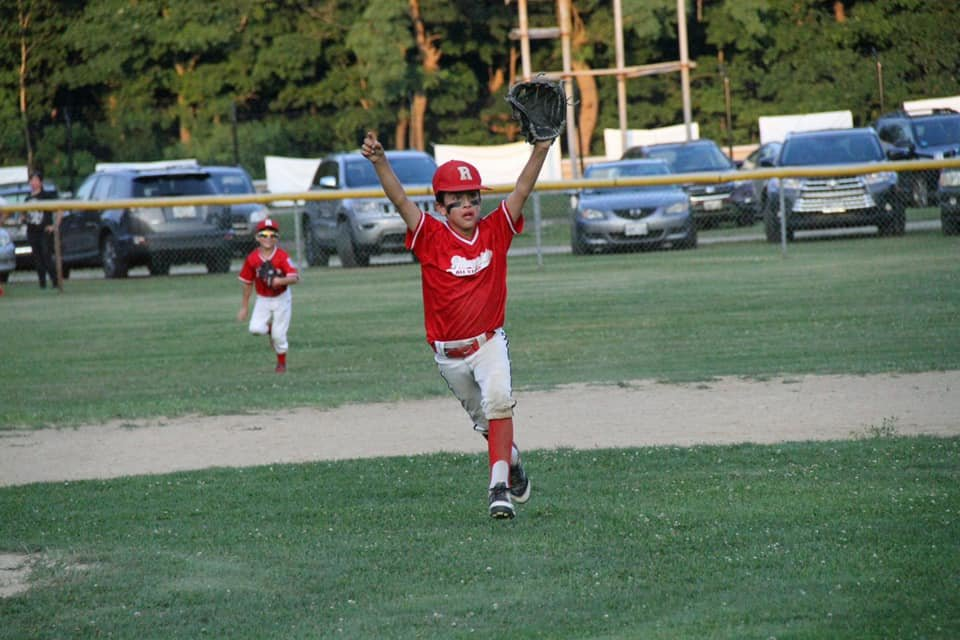 Riverside's Jonathan Renaud celebrating 9-10 Silva Tournament win after making a laser throw to 1st baseman Alex Enright to end the game.