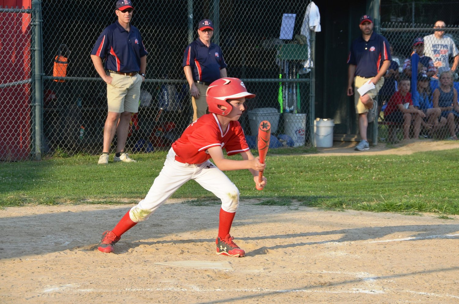 KJ Levesque putting down a perfect bunt for Riverside in game against Rumford. Photo by Kathy Saleeba.
