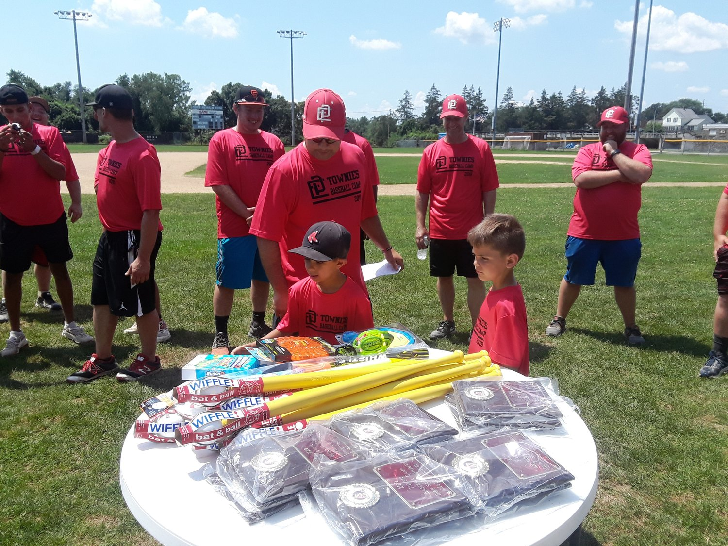 Picking out a prize at Townie Baseball Camp at Pierce Field.