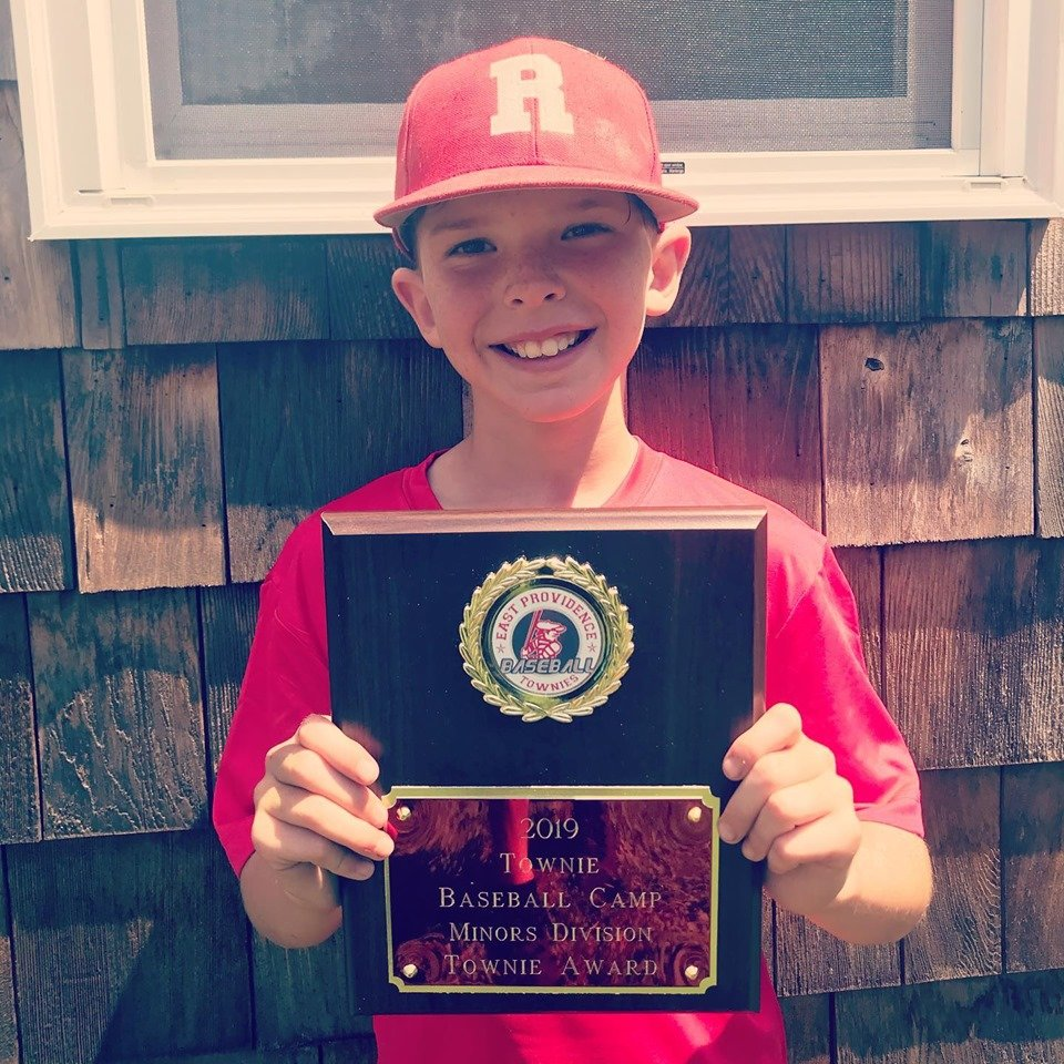 KJ Levesque receives the Townie Award for the minors division of the Townie Baseball Camp.
