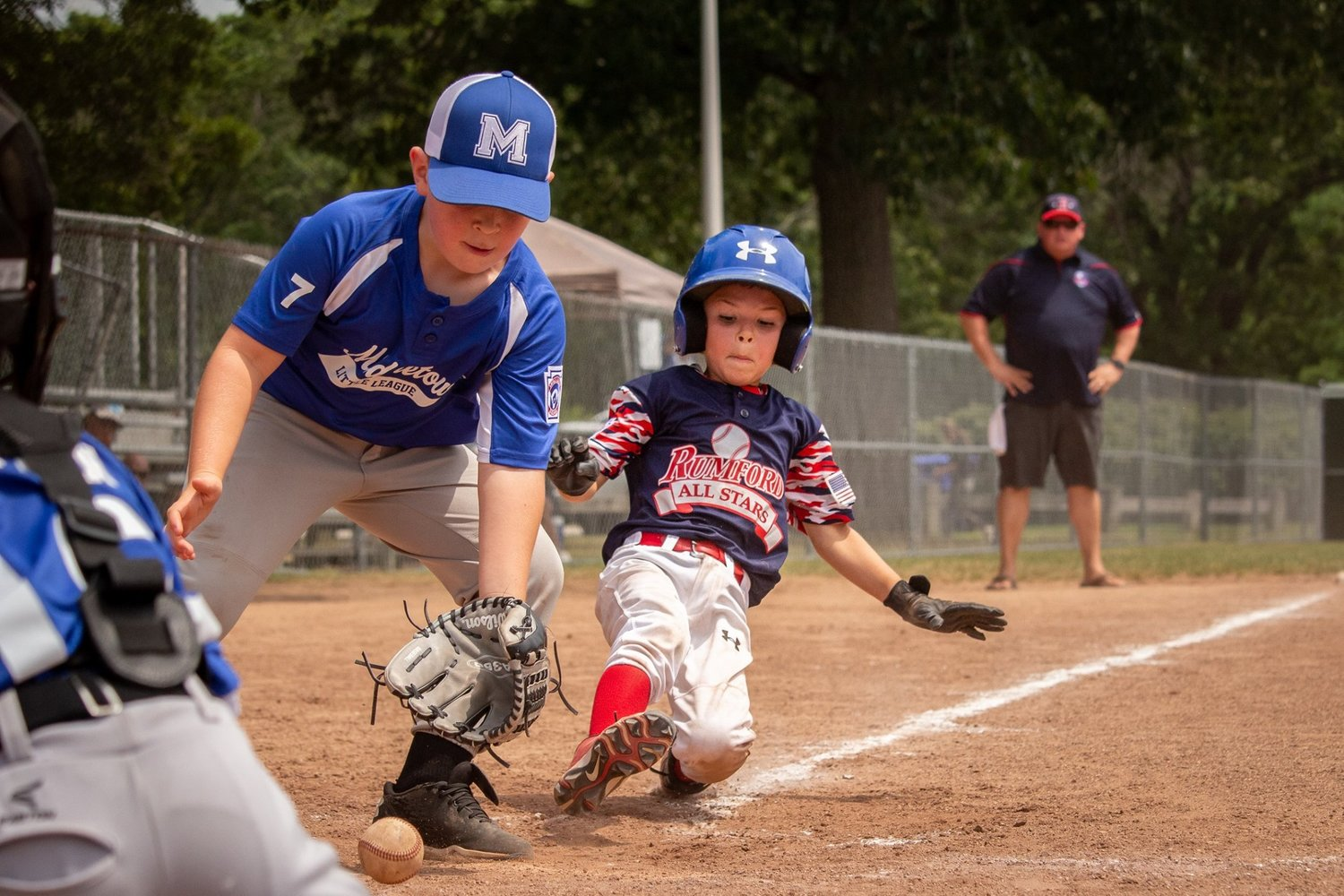 Rumford LL scoring another run. Photo by Nina Levesque.