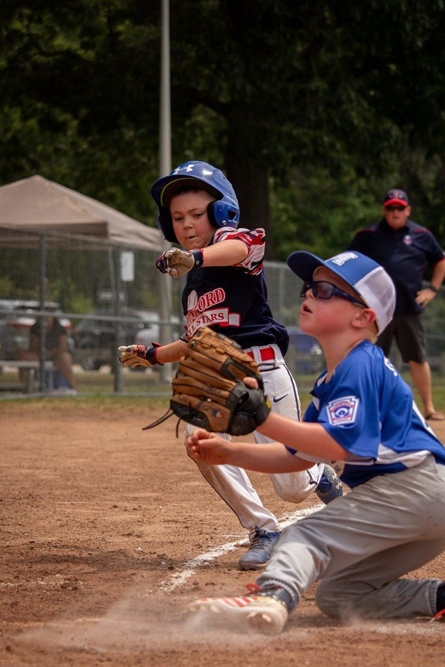 Sliding home safe for Rumford Little League in tourney action in July. Photo by Nina Levesque.