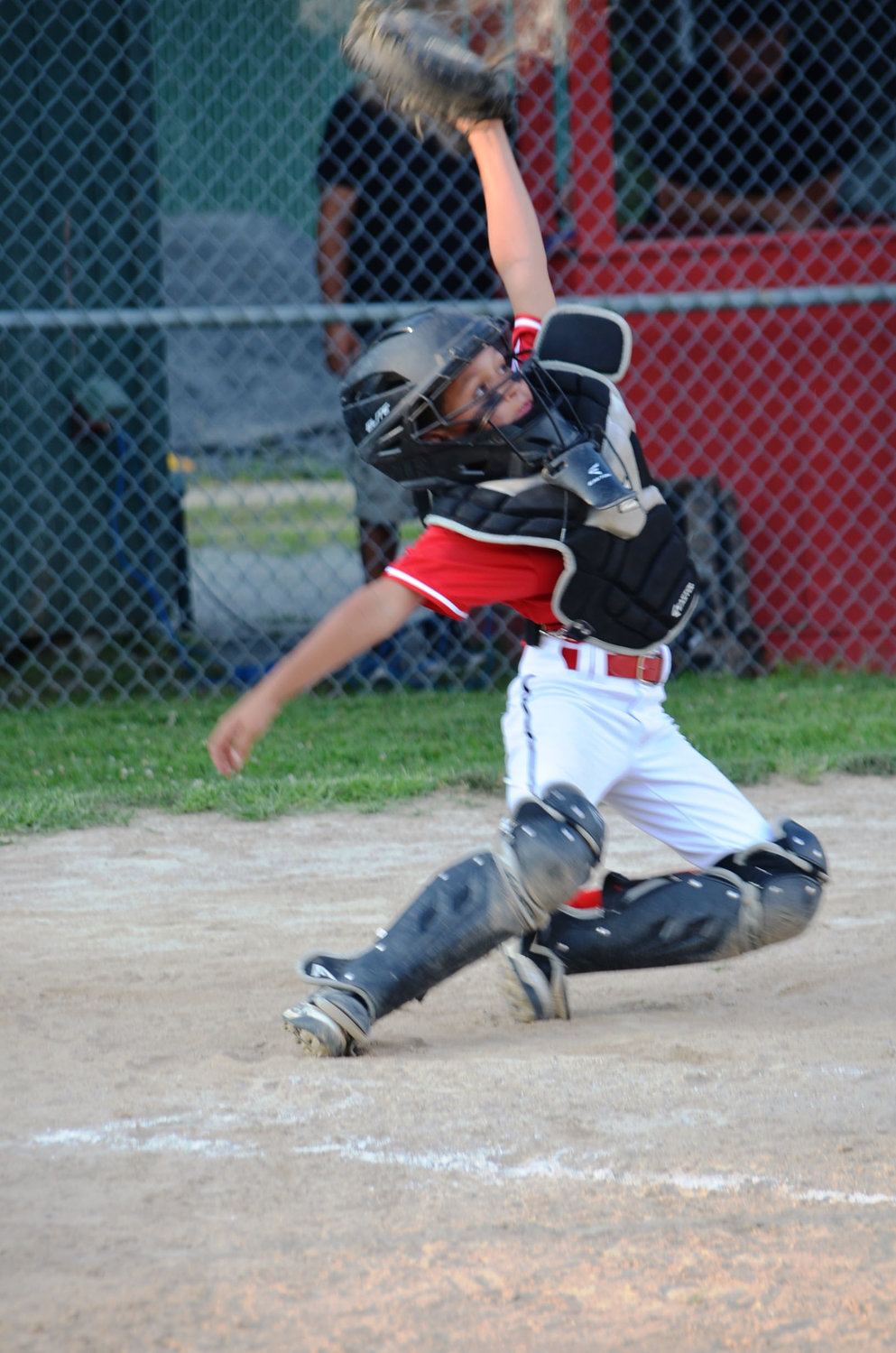 Riverside catcher Jose Fifueroa reaching for a high one in Silva tournament. Photo by Kathy Saleeba