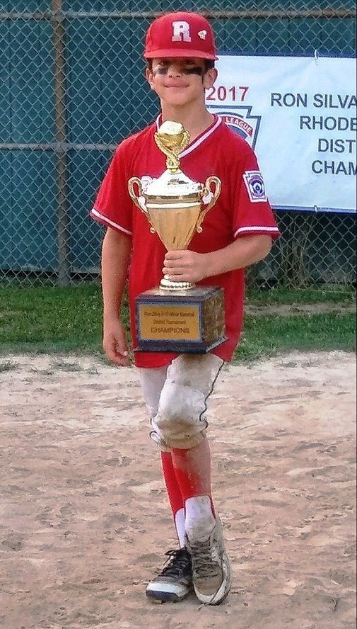 Riverside's Jonathan Renaud holding the Ron Silva Trophy after winning the 2019 tournament on July 29th. Renaud was a top pitcher in the District Two tourney.