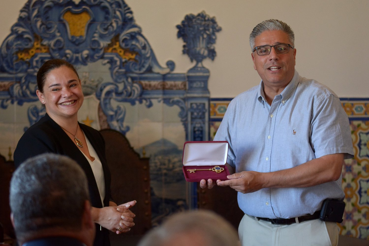 Mayor Bob DaSilva giving the keys to the city from East Providence to Tania Fonseca, Vice President of Ribeira Grande.