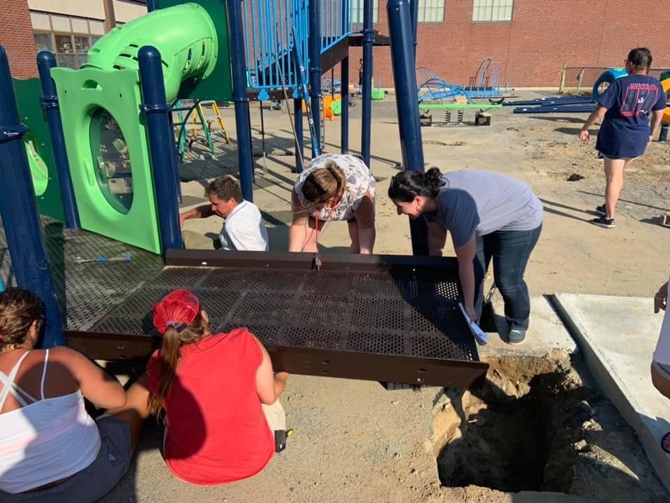 Setting playground equipment in place at Whiteknact School