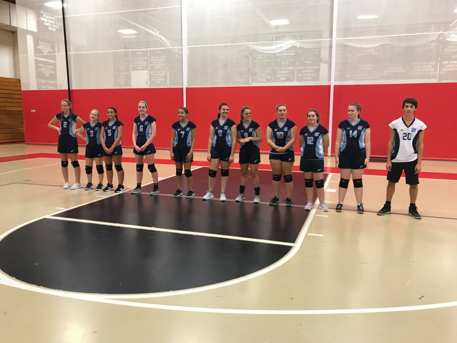 The Seekonk High School volleyball team lines up before Tuesday's season-opener against Durfee.