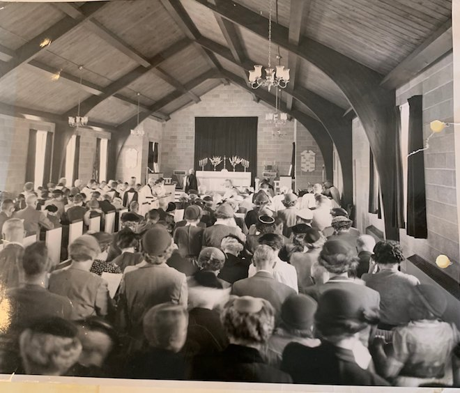 Pictured here is one of the first sermons held at the finished parish building at the Church of the Epiphany, then called St. Michael and All Angels in 1954. Much of the original architecture and pews still remain today.