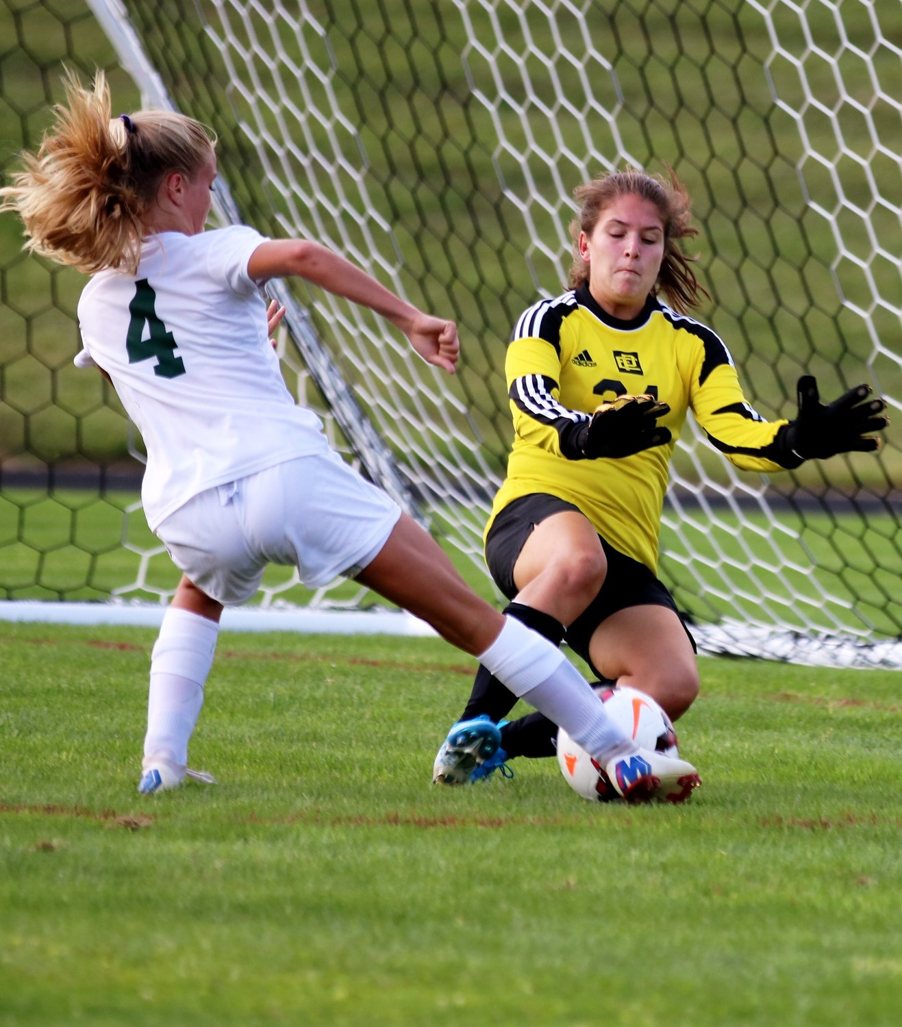 Townies net minder Mia Jackson makes a save on Tessa Azzinaro of Chariho in soccer action.