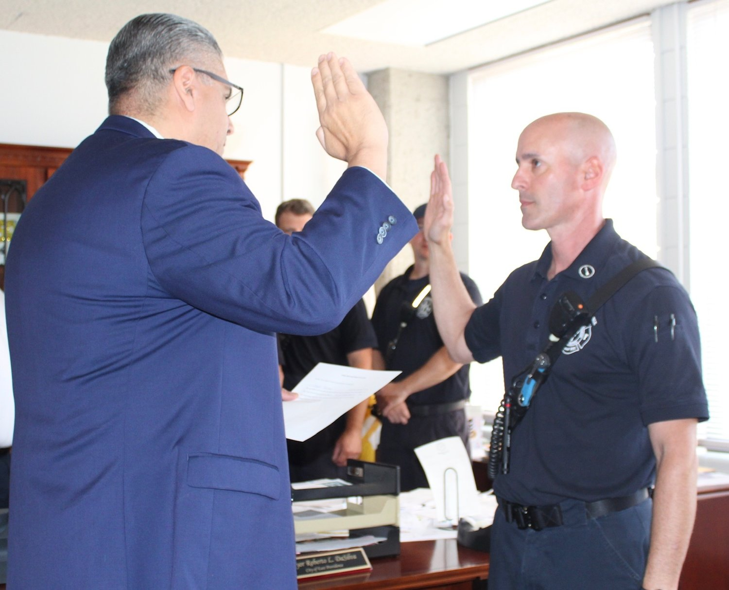 Joseph Burns is sworn in by Mayor Bob DaSilva to the rank of Fire Department lieutenant