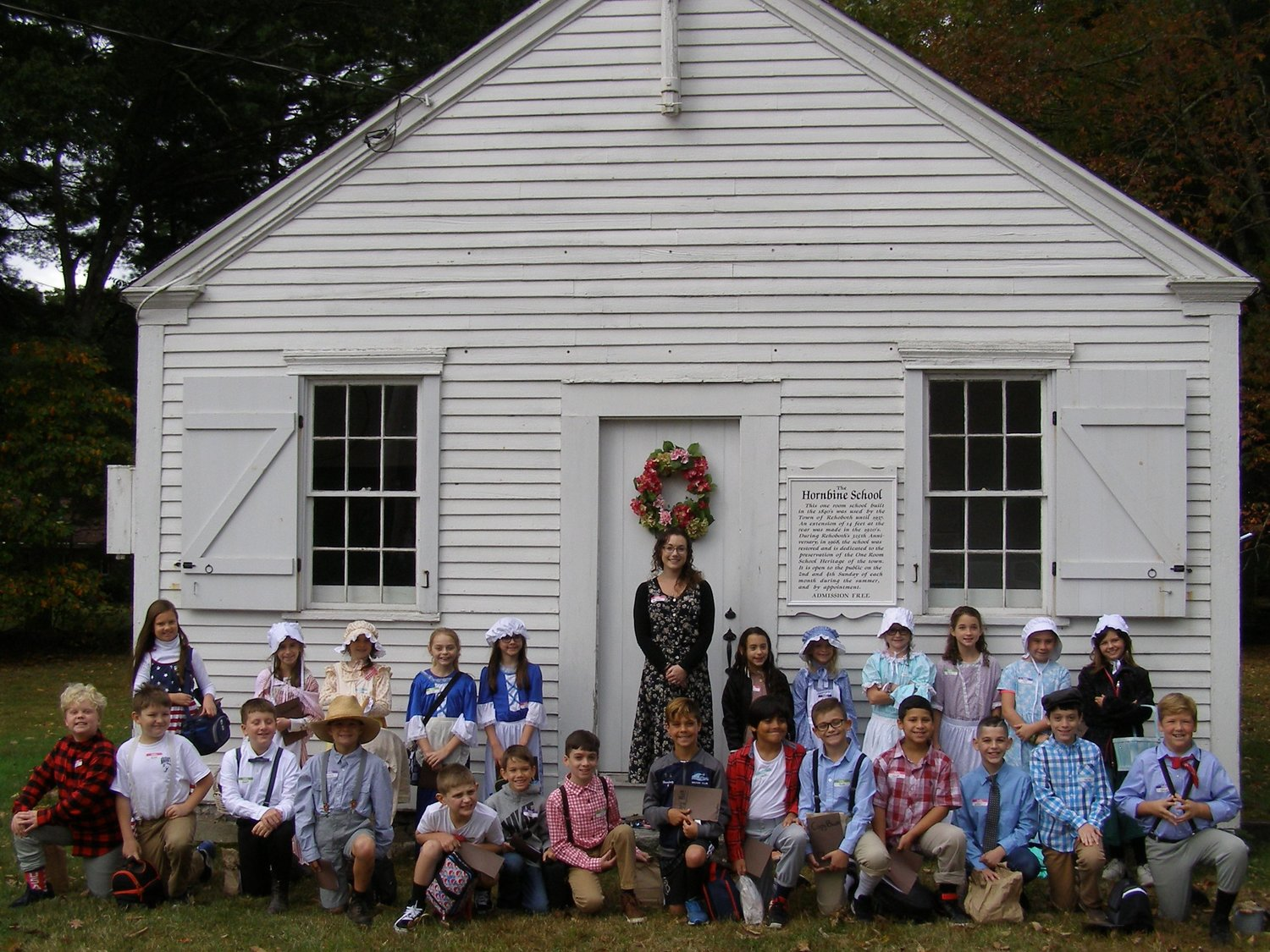 Taylor Sargent's fourth grade Palmer River class, room 44, pose for pictures out in front of the Hornbine School