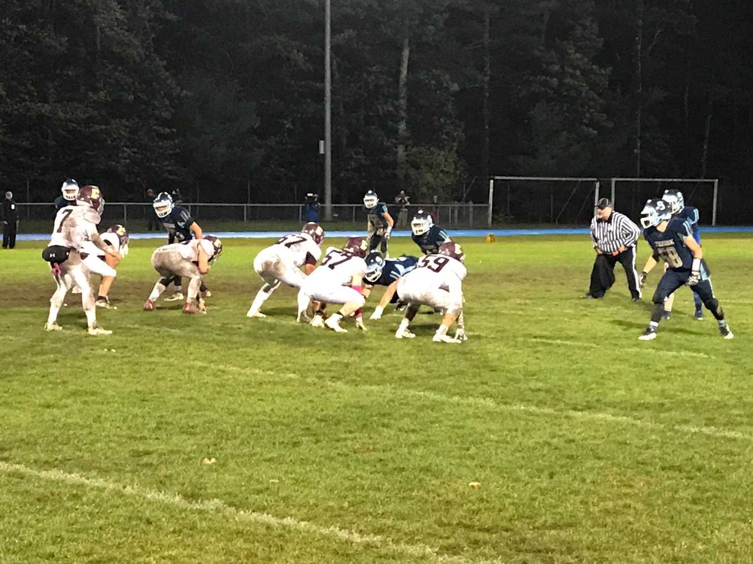 The Seekonk defense gets ready before the ball is snapped.