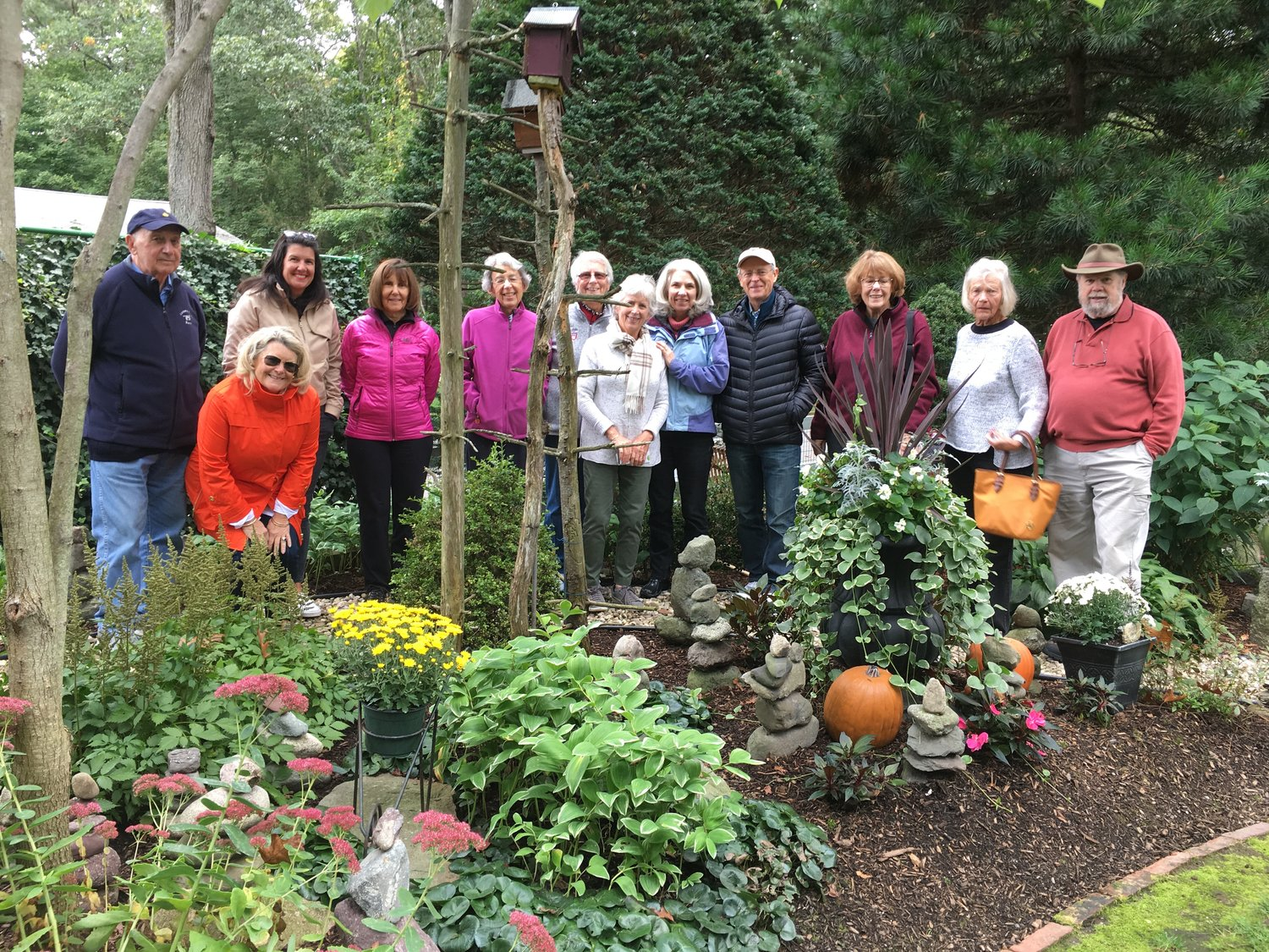Some of the members of the Barrington Garden Club visit the Seekonk garden of David Murray, standing at far right.