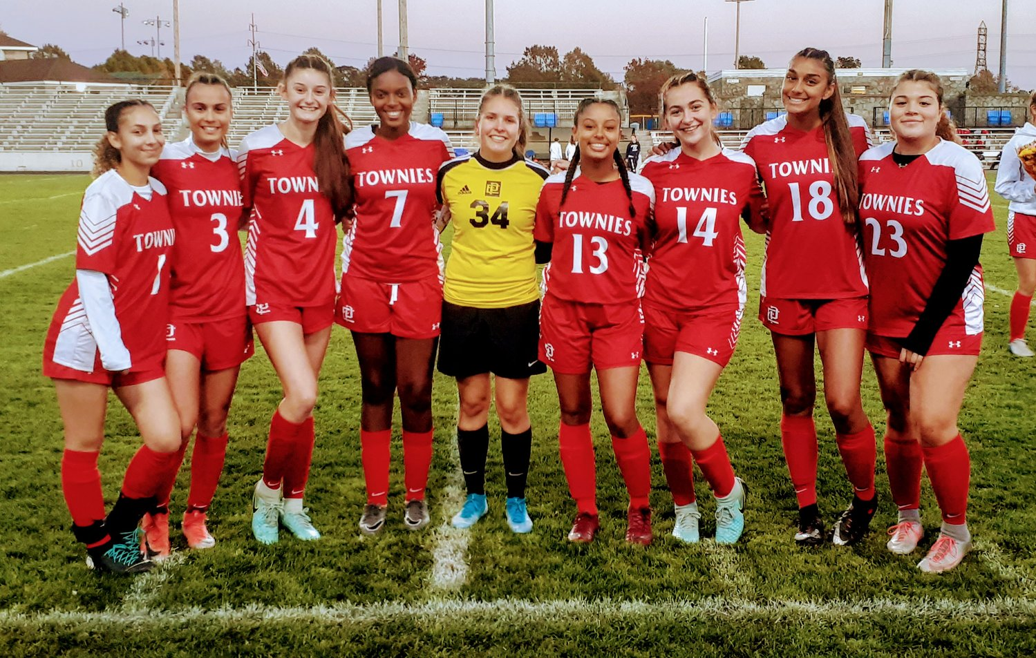 EPHS soccer team seniors honored before Monday's game at Pierce Stadium. Seniors L to R:  Ashley Cassino-Henriquez, Alyssa DeOliveira, Savannah Feola, Luana Rodrigues, Mia Jackson, Isabella Monteiro, Taylor Donnelly, Aaliyah Pattie and Simone Driscoll-Nicholaus.