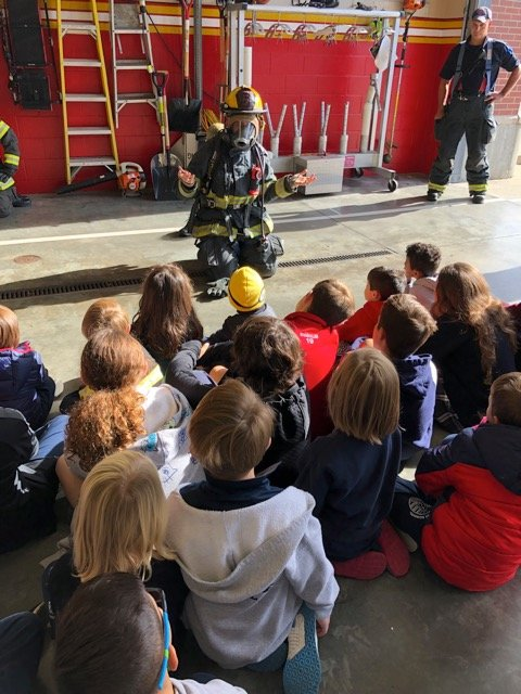 Students learn about the equipment firemen wear