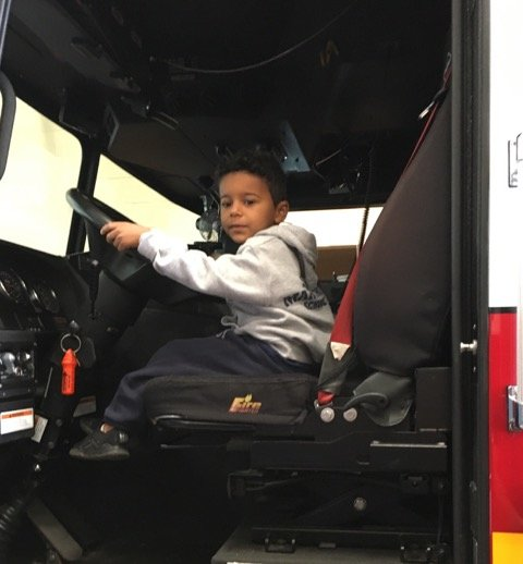 Jonathan Monteiro sits in the fire truck