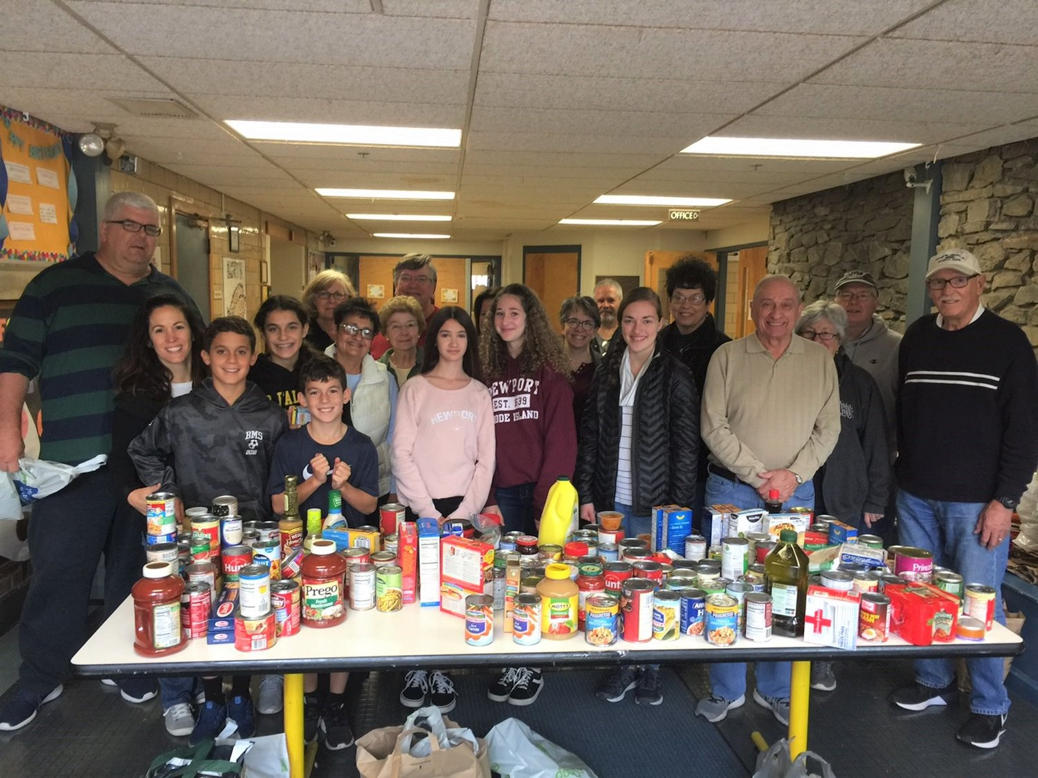 Volunteers from Our Lady of Mt Carmel and Doorways Food Pantry worked together to sort and store the food donated on the recent OLMC parish food drive. Contributions helped support pantries in both Seekonk and Rehoboth.