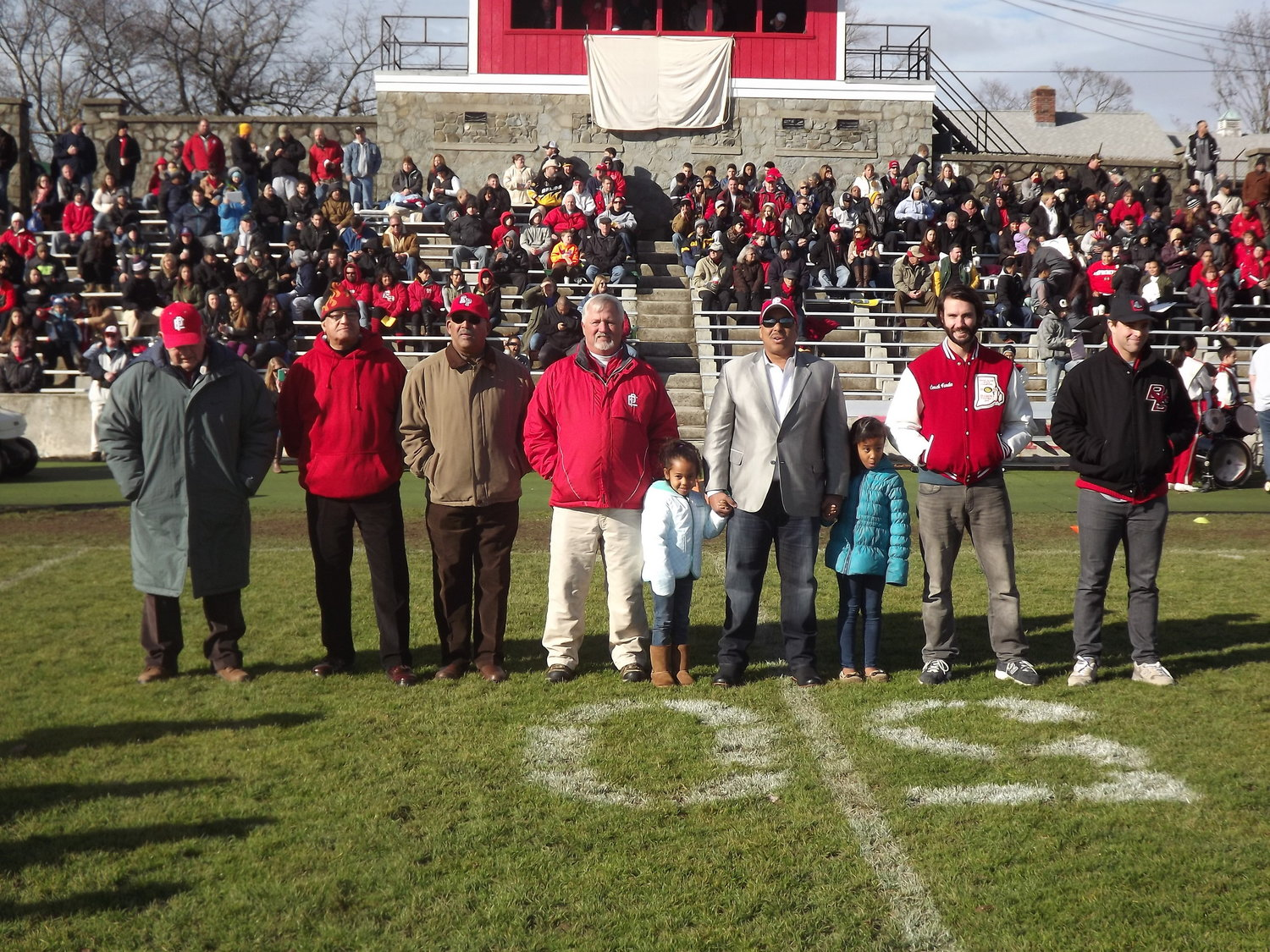 Representing 7 decades of Townie football from the 1940s to 2000s L to R, Bill Stringfellow, Harry Edmonds, Junior Butler, Jim Rose, Matt Lopes, Joe Wahl and Jaime Silva at 2014 game.