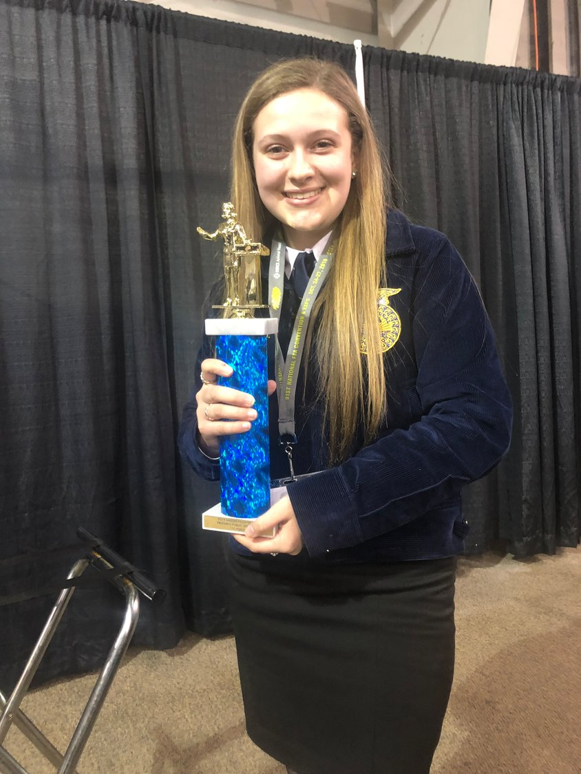 "Hannah Johnson, pictured here with her 1st place trophy at the State FFA Convention went on to deliver a speech about ""Buying Local"" at the National FFA Convention."