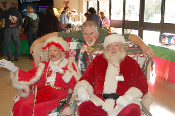 Thomas Harrington Jr., President of the Rumford Towers Residents Association with Santa and Mrs. Santa