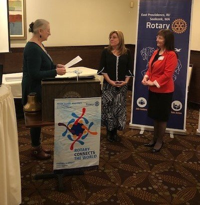 Elise Strom was inducted into the East Providence/Seekonk Rotary Club by Renate Alexander and her sponsor Elisabeth Galligan