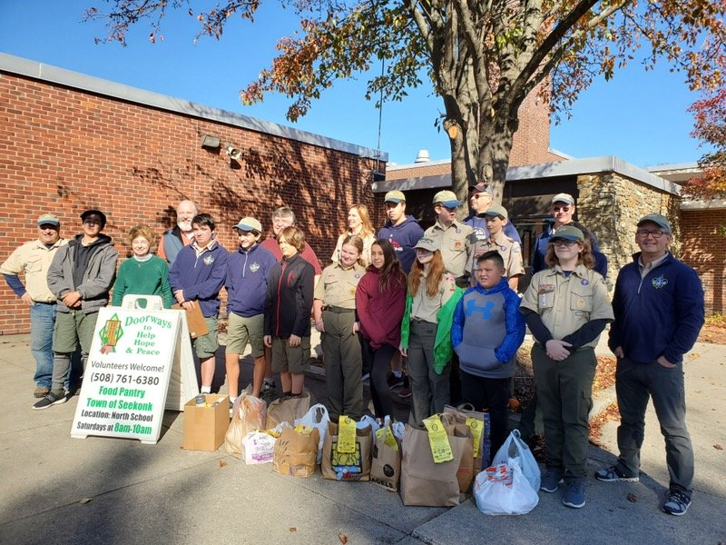 Young men and women from Seekonk BSA Troop 1 & BSA Troop 9, with their parents and Doorways volunteers, at the end of a long day of collecting and sorting donations.