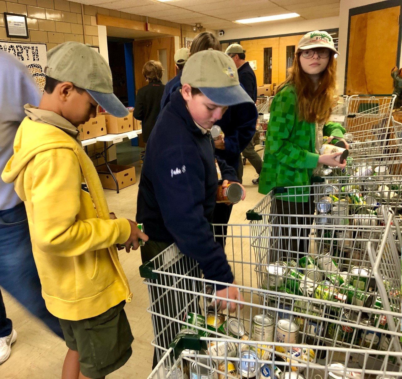 Scouts sorting and preparing the 6600+ lbs. of food for distribution.