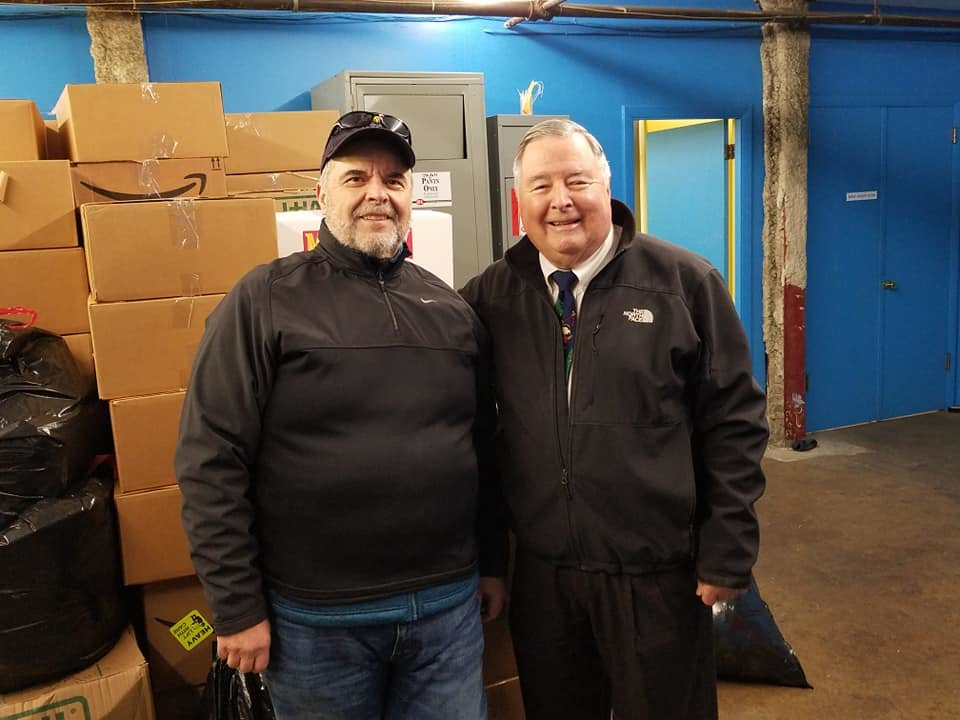 ROVAC co-ordinator Steven Perry, left and Tony DeJesus of Big Blue Bug Solutions during the collection of Christmas gifts for RI veterans