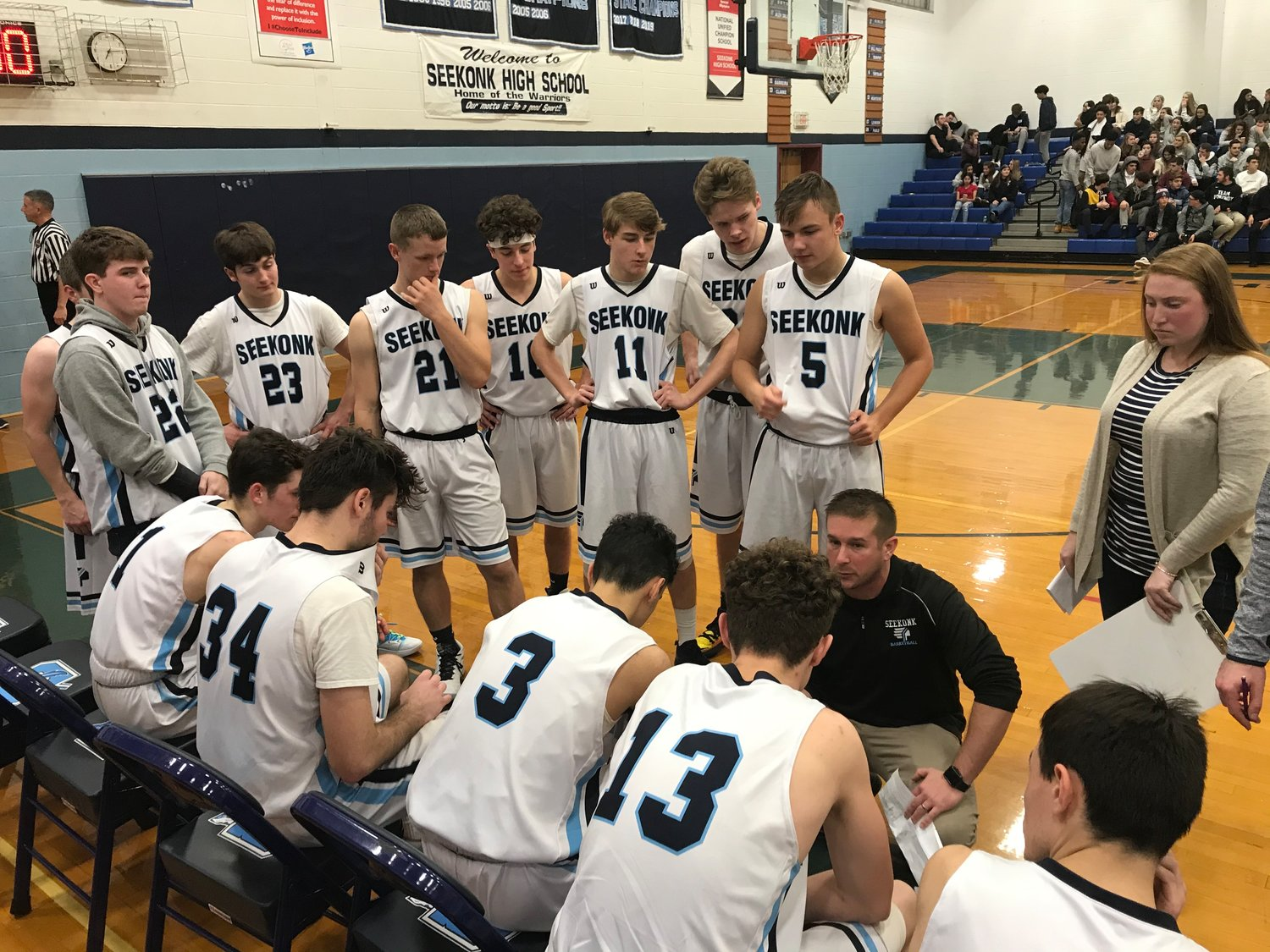 Seekonk boys basketball coach Alex DaLuz talks to the Warriors during a timeout against Blackstone Valley.