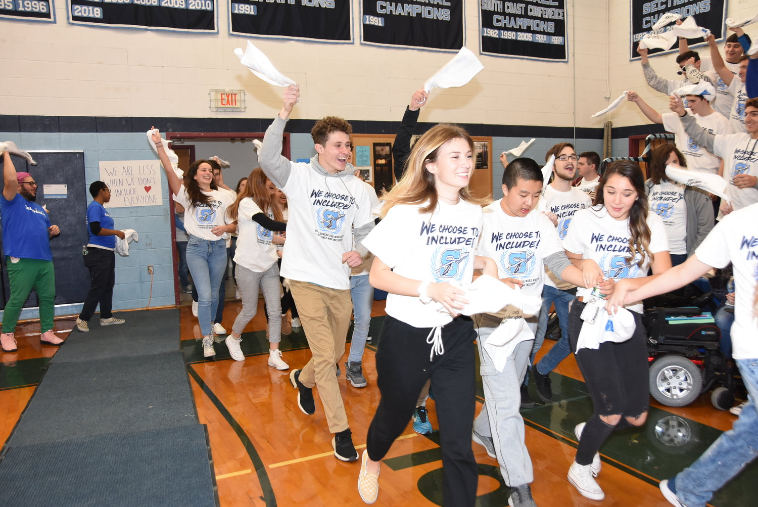 Members of the Unified team run into the gymnasium for the School-wide Assembly.