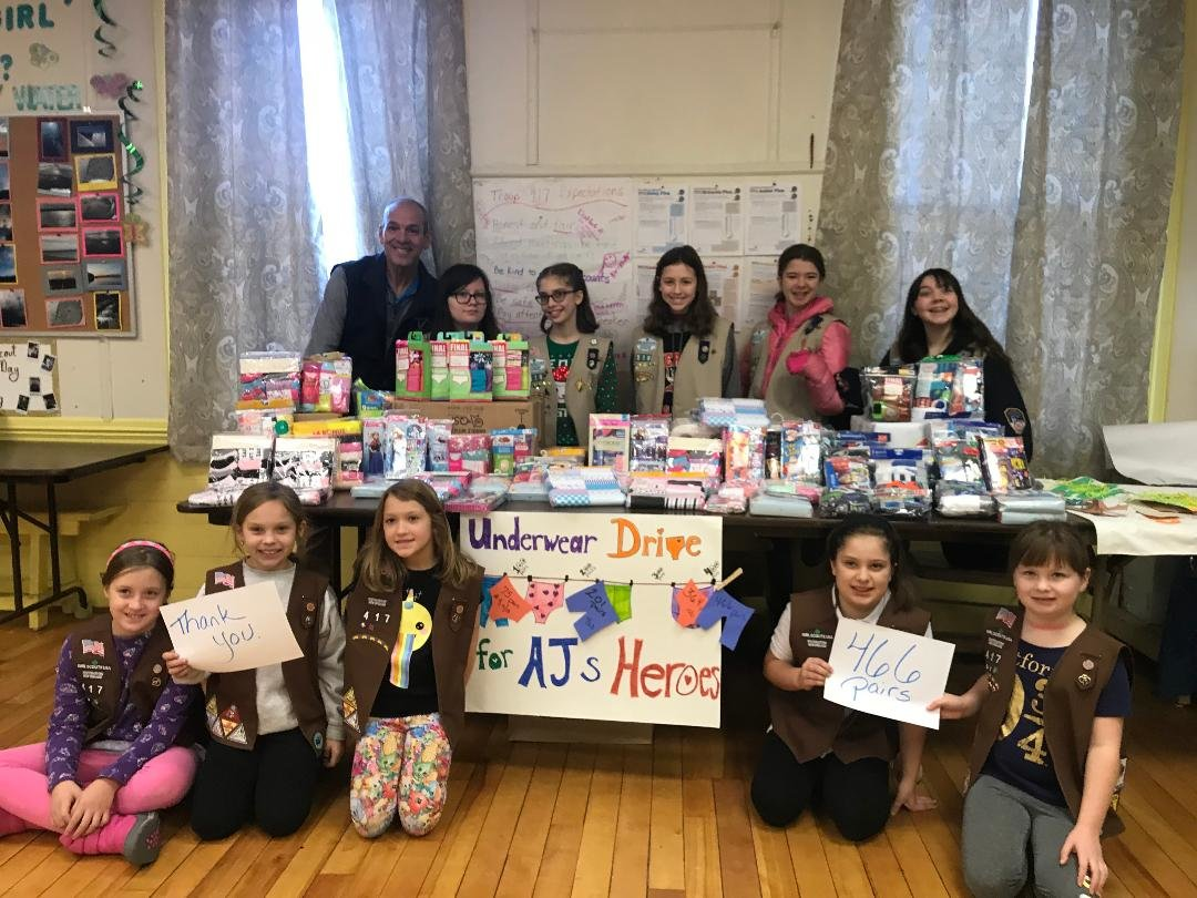 Members of East Providence Girl Scout Troop 417 are shown with Mr. Carl Sweeney, the President of Hope and Faith Drive, LLC, who accepted the donations received from Girl Scouts and other residents of East Providence.