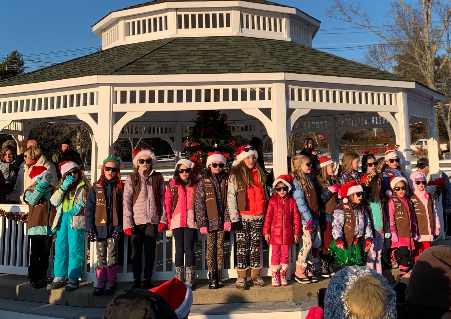On December 7, 2019, Girl Scouts Brownie troop #694 sang holiday songs and performed a dance for the Rehoboth Tree Lighting, along with many other Girl Scouts in attendance.