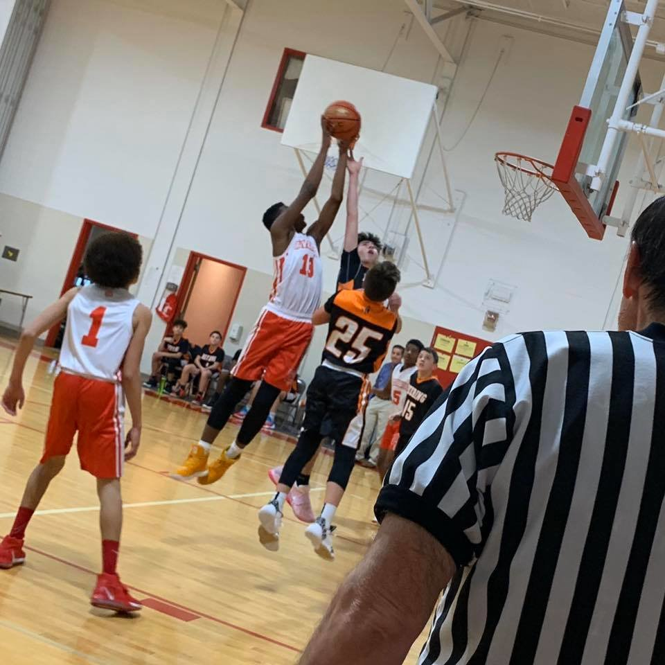 RMS boys basketball remains undefeated in division play
