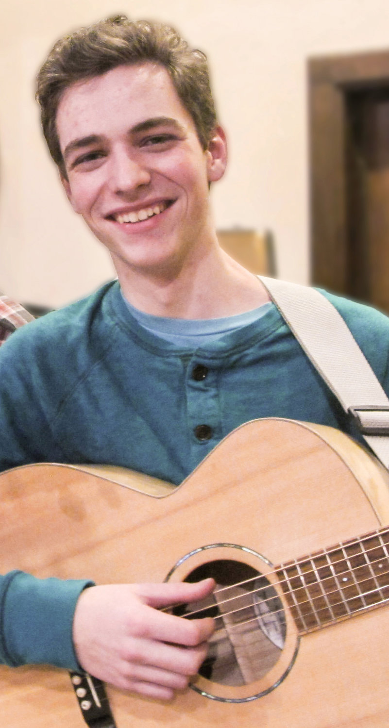 Benjamin Foss performs at the Rehoboth contra dance on Friday, March 13