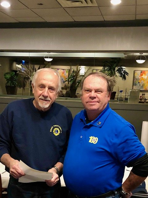 Dick Wood presents to Peter Follows (left) the covenanted Chevron award for his 40 years of service to the Lions Club of East Providence  and the community.  Congratulations and thank you Peter!