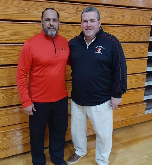 Retiring Townie football Coach Jay Monteiro, left and EP AD Gregg Amore