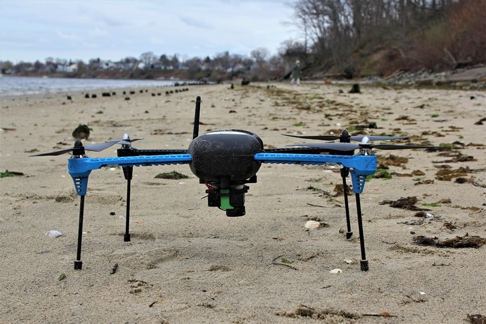 Drone preparation at Crescent Park shoreline to plan beach erosion project.