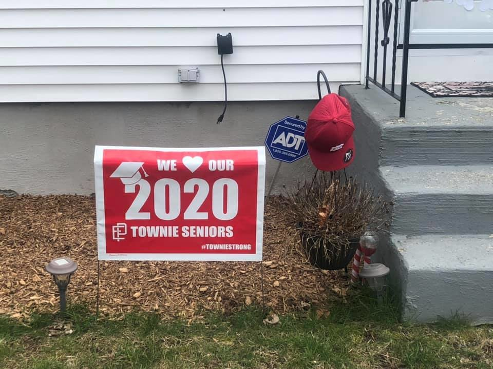 Townie baseball players received a yard sign and baseball cap at season's end