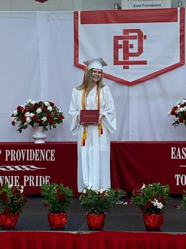 Megan Amore, a 4th generation Townie graduate, receives her diploma at EPHS ceremony.