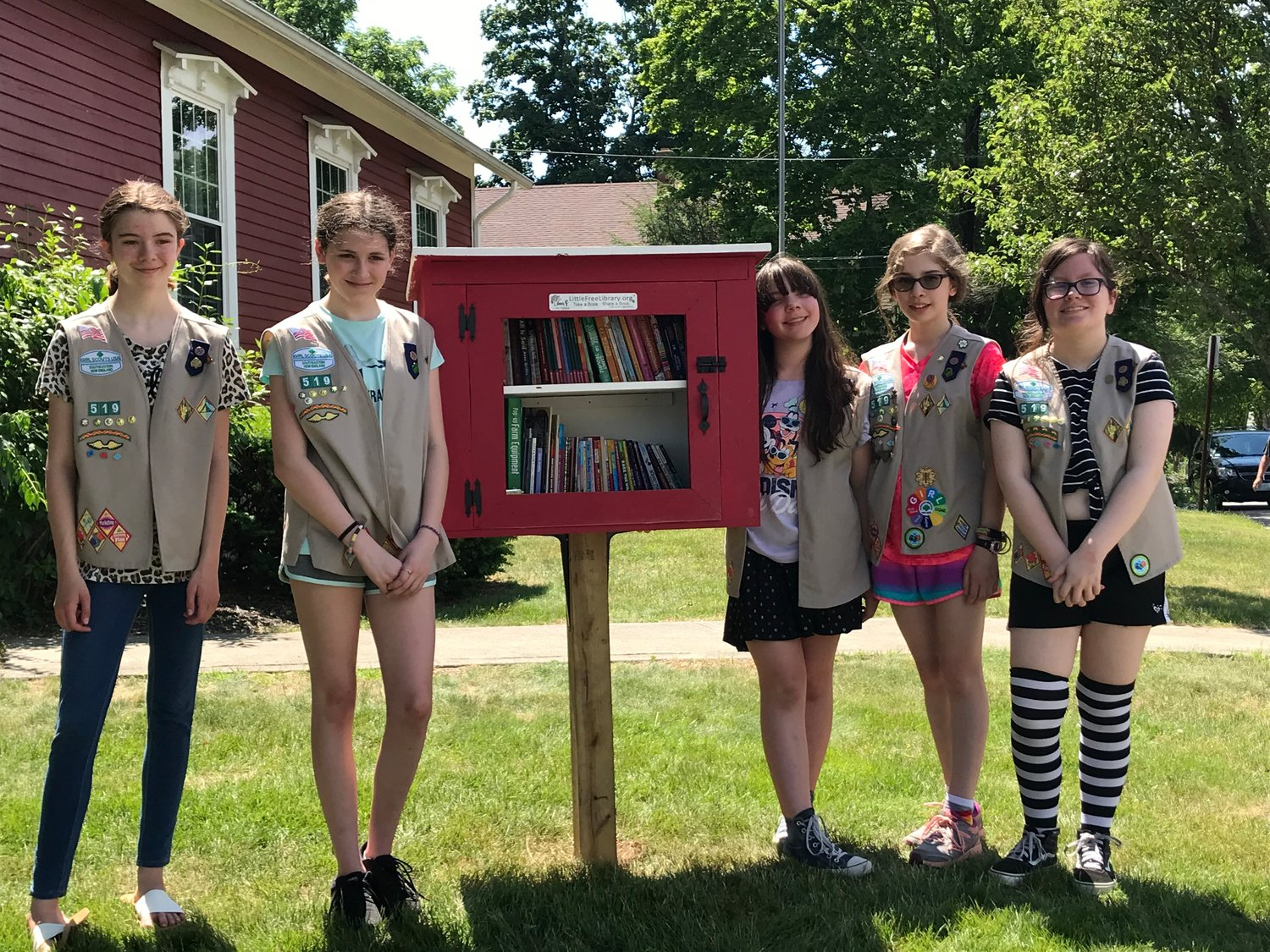 Members of East Providence Troop 519 are shown standing next to the Little Free Library they built.  The library is located at the East Providence Scout House, 351 Willett Avenue in Riverside.  It's a wonderful way to provide access to free books to local family and friends while promoting the Girl Scout way of making the World a Better Place.