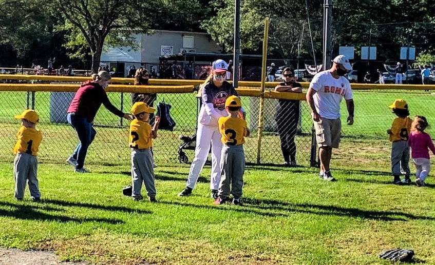 Older Rumford LL players teaching the little guys