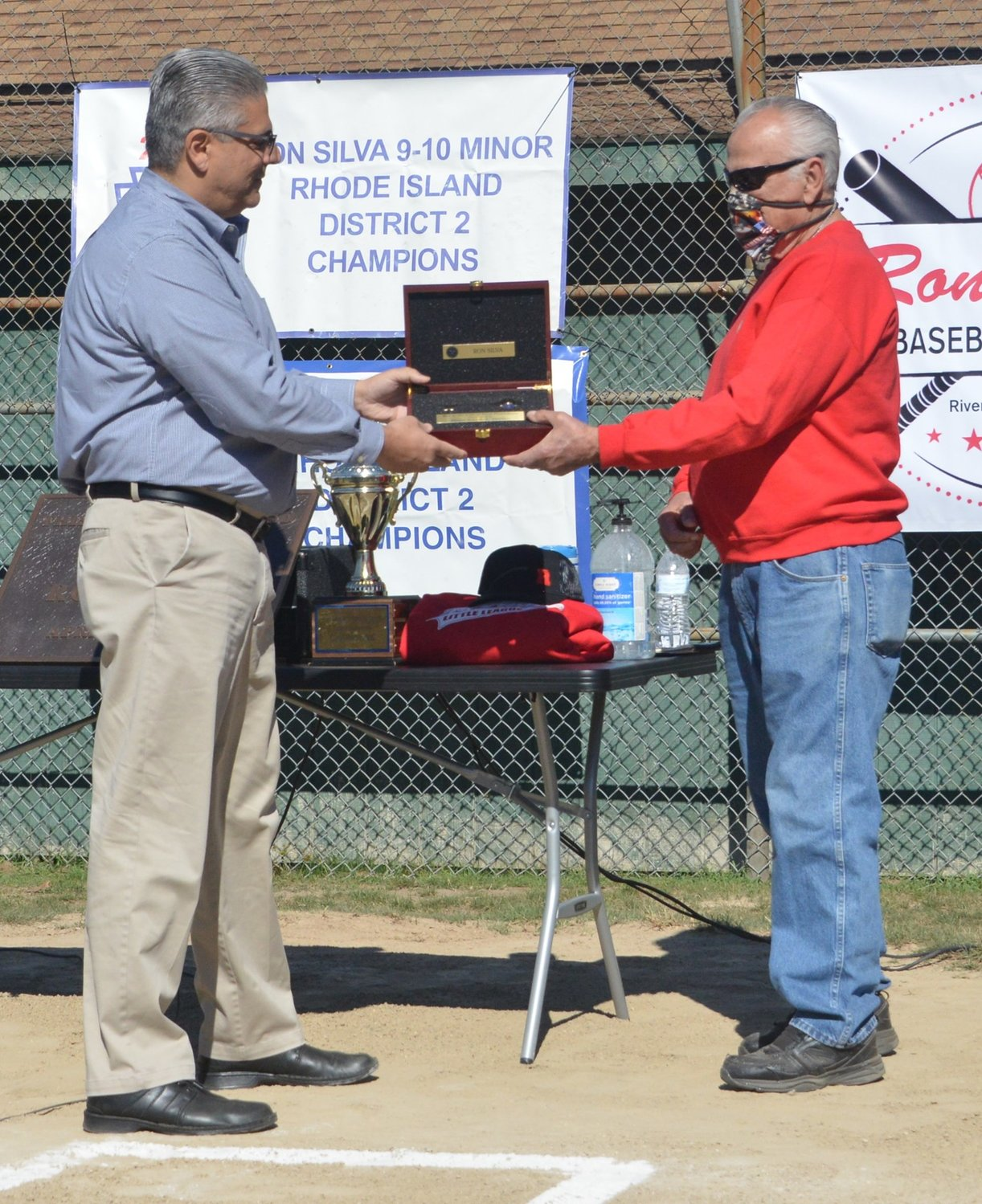 Mayor Bob DaSilva giving Ron Silva a key to the city at Forbes Field last month