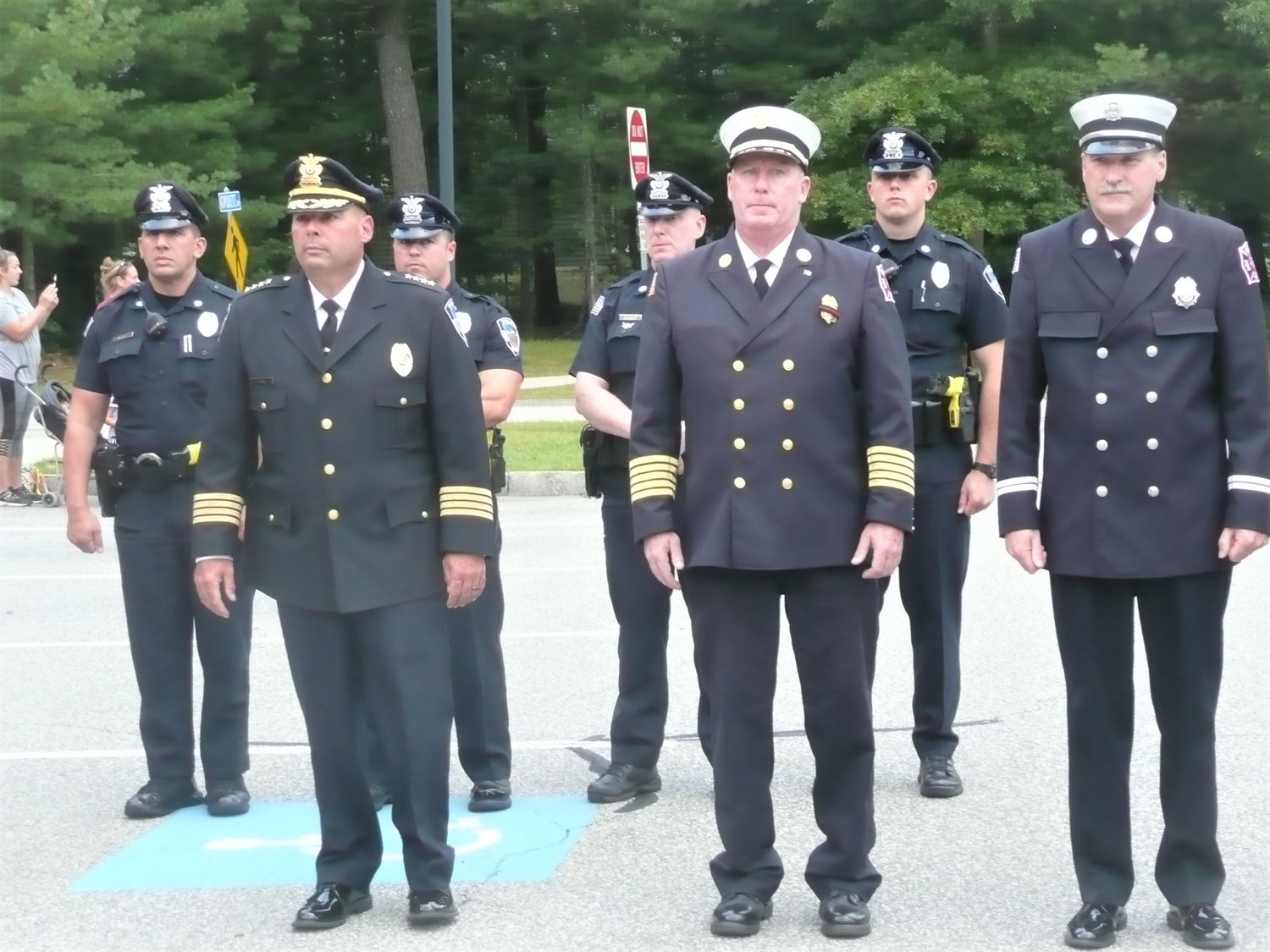 Former Fire Chief Michael Healy (center), former Police Chief Frank John is to his left.